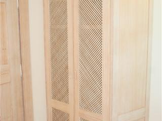 Placard avec portes caillebotis